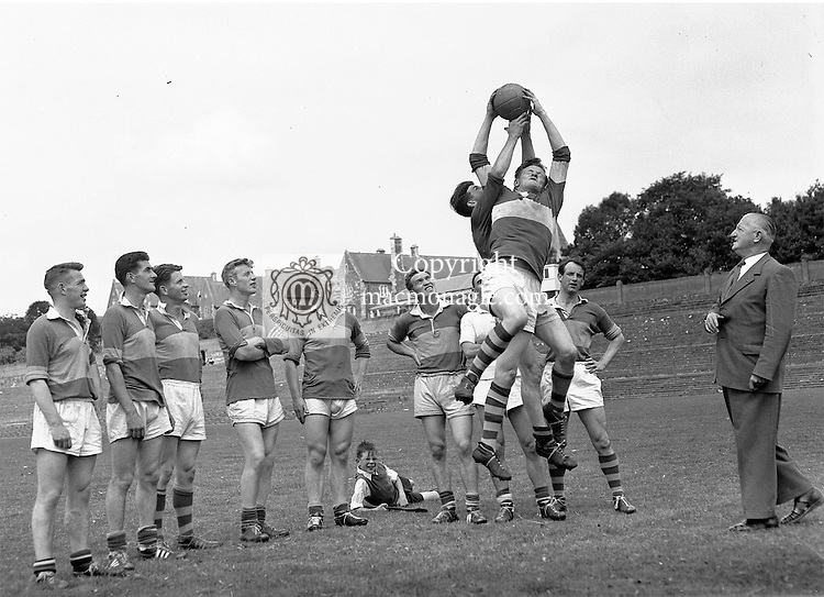 Dr Eamonn O'Sullivan, the famed Kerry trainer teaching his players how to field the ball during a training session in Fitzgerald Stadium, Killarney in 1955..Picture by Harry MacMonagle.Photo:-macmonagle.com archive