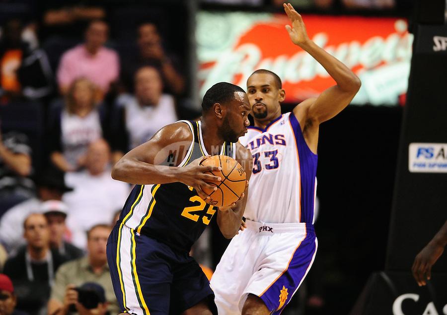 Oct. 12, 2010; Phoenix, AZ, USA; Utah Jazz center (25) Al Jefferson is defended by Phoenix Suns forward (33) Grant Hill during a preseason game at the US Airways Center. Mandatory Credit: Mark J. Rebilas-