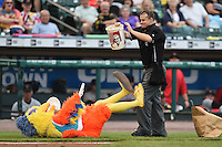 Umpire Brad Myers holds up a KFC bucket at the The Famous San Diego Chicken for on field entertainment during a game between the Indianapolis Indians and Rochester Red Wings on July 26, 2014 at Frontier Field in Rochester, New  York.  Rochester defeated Indianapolis 1-0.  (Mike Janes/Four Seam Images)