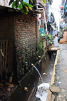 Waste water empties into a drainage channel in a slum community in central Jakarta.<br />