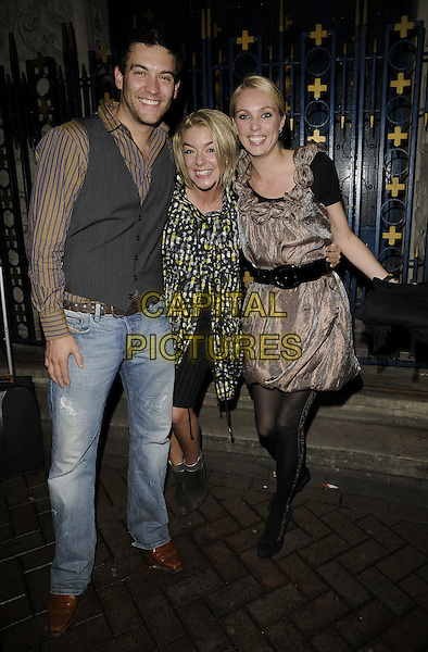 "KEVIN SACRE, SHERIDAN SMITH & CAMILLA DALLERUP.""Blowing Whistles"" press night, Leicester Square theatre, Leicester Square, London, England..October 23rd, 2008.full length black coat jacket dress white yellow pattern print ankle boots silver trim gold shiny sparkly dress tights jeans denim grey gray waistcoat  striped belt stripes shirt .CAP/CAN.©Can Nguyen/Capital Pictures."