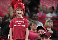 Paxton Smith, 4, smiles before the Razorback basketball game against Kentucky Sunday Feb. 9, 2020 at Bud Walton Arena in Fayetteville. Paxton was sitting with his dad, Kaleb Paxton of Gentry. More images at nwaonline.com/200210Daily/ (NWA Democrat-Gazette/J.T. Wampler)