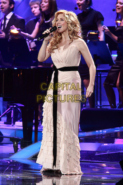 Lara Fabian.Concert in Moscow.November 3rd, 2010.on stage in concert live gig performance performing music full length white dress singing black sash waist .CAP/PER/SB.©SB/PersonaStars/CapitalPictures