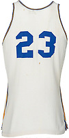 BNPS.co.uk (01202 558833)<br /> Pic: HeritageAuctions/BNPS<br /> <br /> Obama shares the 23 number with David Beckham and Michael Jordan.<br /> <br /> Barack Obama's high school basketball top has emerged for sale for £80,000. ($100,000)<br /> <br /> The former president was a callow 18 year old when he wore the white number 23 jersey for Punahou School in Hawaii 40 years ago.<br /> <br /> His love of the sport endured into adulthood and he was frequently seen playing it at the White House.<br /> <br /> The top was due to be discarded at the end of the 1978/79 season, but his team-mate Peter Noble decided to take it home as he had also worn it when Obama was not able to play.<br /> <br /> He kept hold of it as a souvenir as they had become state champions. Now, four decades later, he is selling it with Heritage Auctions, of Dallas, Texas.