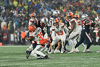 FOXBOROUGH, MA - OCTOBER 27: New England Patriots Wide Receiver Mohamed Sanu #14 catches a short pass and is tackled by Cleveland Browns Safety Jermaine Whitehead #35 during a game between Cleveland Browns and New Enlgand Patriots at Gillettes on October 27, 2019 in Foxborough, Massachusetts.