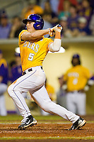 Mason Katz #5 of the LSU Tigers follows through on his swing against the Wake Forest Demon Deacons at Alex Box Stadium on February 18, 2011 in Baton Rouge, Louisiana.  The Tigers defeated the Demon Deacons 15-4.  Photo by Brian Westerholt / Four Seam Images