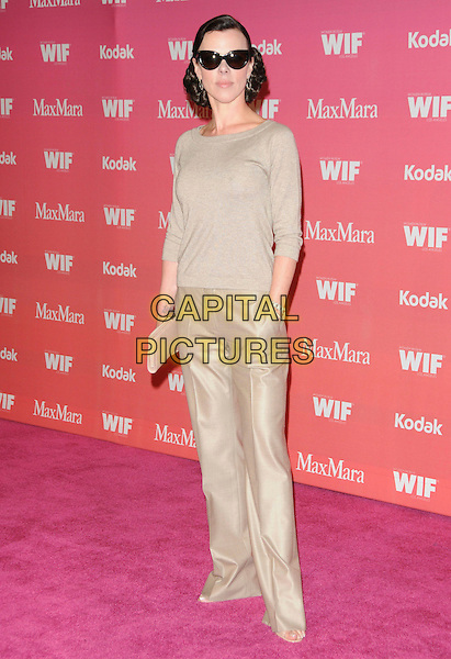 DEBI MAZAR .at The Women in Film 2009 Crystal .and Lucy Awards held at The Hyatt Regency Century Plaza in Century City, California, USA, June 12th 2009                                                                     .full length beige trousers jumper top clutch bag sunglasses .CAP/DVS.©Debbie VanStory/RockinExposures/Capital Pictures