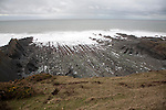 Rocky wave cut platform erosional landforms with ridges formed by eroded tilted strata at Hartland Quay, north Devon, England