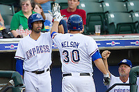 Round Rock Express outfielder Ryan Spilborghs #19 greets teammate Brad Nelson #30 after his homerun during the Pacific Coast League baseball game against the Nashville Sounds on August 26th, 2012 at the Dell Diamond in Round Rock, Texas. The Sounds defeated the Express 11-5. (Andrew Woolley/Four Seam Images).