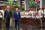 Palestinian President Mahmoud Abbas and Cuban President Miguel Diaz-Canel review an honour guard at the Revolution Palace in Havana, Cuba, May 11, 2018. Photo by Thaer Ganaim