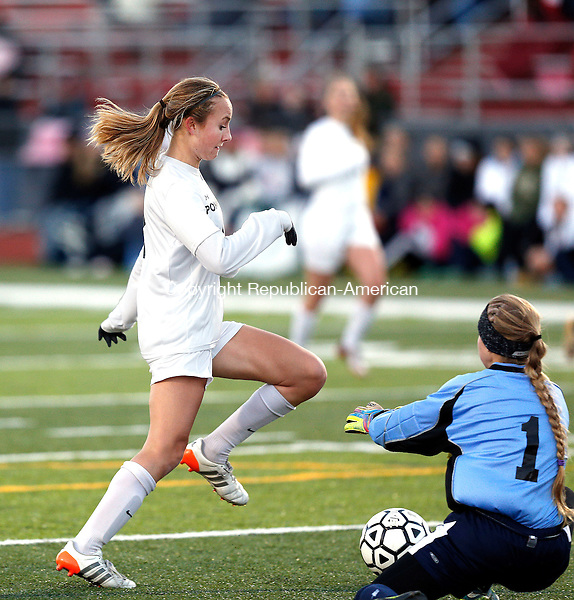 Southbury, CT- 11 November 2016-111116CM17- Pomperaug's Anna Carnes goes around Avon keeper, Olivia Zapatka to score a goal during their state tournament matchup on Friday.     Christopher Massa Republican-American