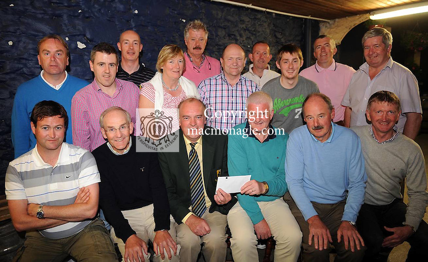 At the presentation of prizes in Foley's Bar, Killarney, of the  inaugural  Fitzgerald Stadium Golf Classic that took  place at O'Mahonys Point, Killarney last Thursday, were front from left, Denis Pio Moriarty, Brendan Lynch, Dermot Griffin, East Kerry Board Chairman, sponsor, Paudie Lynch, Captain of the winning Beaufort GAA Club team,   Der Brosnan, Fitzgerald Stadium Committee Chairman and Dan Coffey.  Back from left are John Culloty, Diarmuid Kelleher, Philip Gammell, Noreen Buckley, Seamie O'Connor, Andy O'Sullivan,  Daithi McGillycuddy, Colm Foley, Tommy Galvin and John Lenihan. Picture: Eamonn Keogh ( MacMonagle, Killarney).