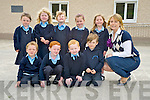Pictured with their teacher Mrs Joy, Glenbeigh National School, during their first day at the school on Thursday were Keith Moriarty, Daniel O'Sullivan, Conan Sheahay, Harvey Mangan, Mary Kate Smith, Emily O'Shea, Clodagh Sheahay, Chloe O'Shea and Seodha O'Donovan.........