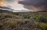 Idaho, scouth central, Custer County, Mackay. The Lost River Range on the right enshrouded in extreme weather at sunset in late spring.