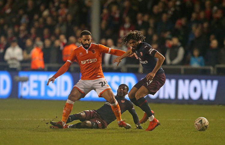 Blackpool's Liam Feeney battles with Arsenal's Ainsley Maitland-Niles (grounded) and Mohamed Elneny<br /> <br /> Photographer Stephen White/CameraSport<br /> <br /> Emirates FA Cup Third Round - Blackpool v Arsenal - Saturday 5th January 2019 - Bloomfield Road - Blackpool<br />  <br /> World Copyright &copy; 2019 CameraSport. All rights reserved. 43 Linden Ave. Countesthorpe. Leicester. England. LE8 5PG - Tel: +44 (0) 116 277 4147 - admin@camerasport.com - www.camerasport.com