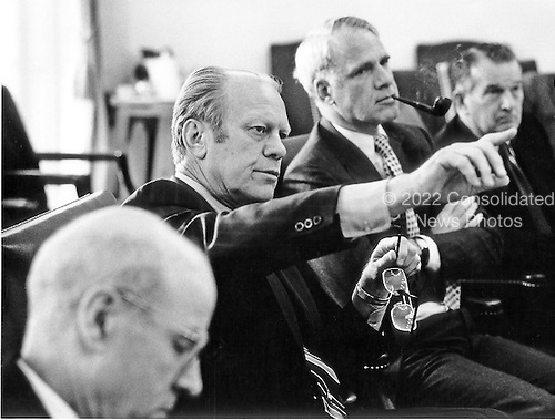 United States President Gerald R. Ford gestures a map of Cambodia as he makes a key point during a National Security Council (NSC) meeting on the Cambodian - United States ship incident at the White House in Washington, D.C. on May 14, 1975.  Attending the meeting from left to right: Robert S. Ingersol of the Department of State; President Ford; United States Secretary of Defense James R. Schlesinger; and Deputy Secretary of Defense William P. Clements, Jr.<br /> Credit: David Hume Kennerly - White House via CNP<br /> Mandatory Credit: David Hume Kennerly / White House via CNP
