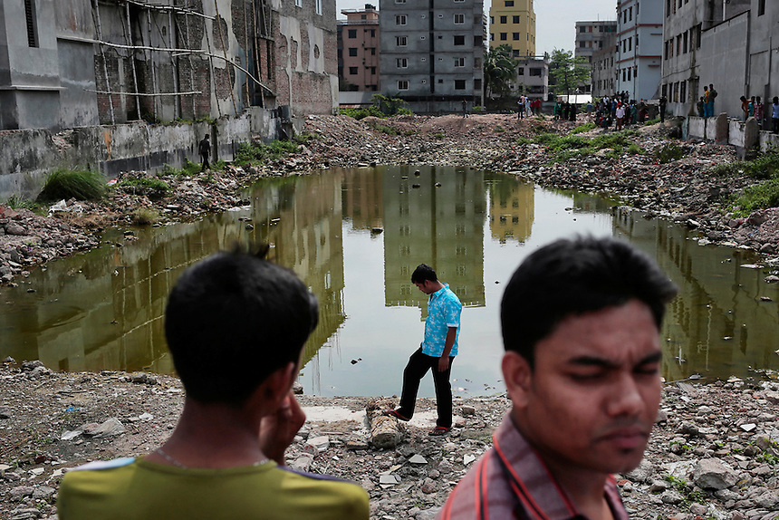 Bangladeshi family members of victims of Rana Plaza building collapse, stand at the site of the accident in Savar, near Dhaka, Bangladesh.