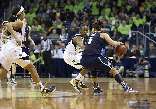 March 04, 2013:  Connecticut guard Caroline Doty (5) dribbles the ball as Notre Dame guard Kaila Turner (15) defends during NCAA Basketball game action between the Notre Dame Fighting Irish and the Connecticut Huskies at Purcell Pavilion at the Joyce Center in South Bend, Indiana.  Notre Dame defeated Connecticut 96-87 in triple overtime.
