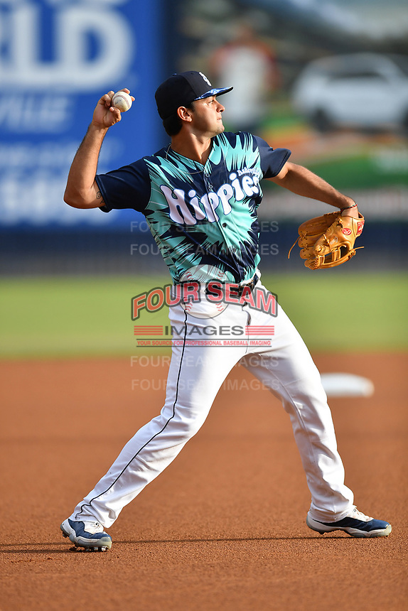 Asheville Tourists third baseman Coco Montes (5) throws to first base during a game against the Greenville Drive on Hippie Night at McCormick Field on July 11, 2019 in Asheville, North Carolina. The Drive defeated the Tourists 6-2. (Tony Farlow/Four Seam Images)