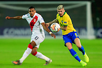 ARMENIA, COLOMBIA - JANUARY 19: Brazil's Caio Henrique fights for the ball against Peru's Fernando Pacheco during their CONMEBOL Pre-Olympic soccer game at Centenario Stadium on January 19, 2020 in Armenia, Colombia. (Photo by Daniel Munoz/VIEW press/Getty Images)