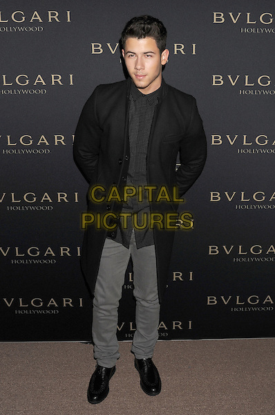 WEST HOLLYWOOD, CA- FEBRUARY 25: Musician Nick Jonas arrives at the BVLGARI 'Decades Of Glamour' Oscar Party Hosted By Naomi Watts at Soho House on February 25, 2014 in West Hollywood, California.<br /> CAP/ROT/TM<br /> &copy;Tony Michaels/Roth Stock/Capital Pictures