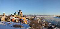 View of Quebec City and the Saint Lawrence river in winter, Quebec, Canada. On the left is the Chateau Frontenac, opened 1893, designed by Bruce Price as a chateau style hotel for the Canadian Pacific Railway company or CPR. The building was extended and the central tower added in 1924, by William Sutherland Maxwell. It is now a hotel, the Fairmont Le Chateau Frontenac, and is listed as a National Historic Site of Canada. The Historic District of Old Quebec is listed as a UNESCO World Heritage Site. Picture by Manuel Cohen