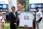 Hideki Matsui, Derek Jeter (Yankees),<br /> JULY 28, 2013 - MLB :<br /> Hideki Matsui poses with a framed number 55 jersey and Derek Jeter of the New York Yankees after receiving it from him as Yankees general manager Brian Cashman (L) looks on during his official retirement ceremony before the Major League Baseball game against the Tampa Bay Rays at Yankee Stadium in The Bronx, New York, United States. (Photo by AFLO)