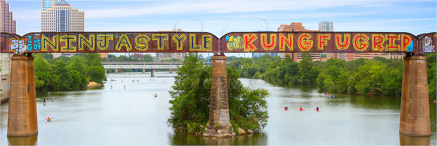 From the Pedestrian Bridge that overlooks Ladybird Lake and the Austin skyline, this view of the traintracks and graffiti is what you see. Beneath the bridge, kayaks, canoes, and wake-boarders enjoy the cool waters of the Colorado River. This Austin landscape image was captured in the morning on a perfect June morning in central Texas.