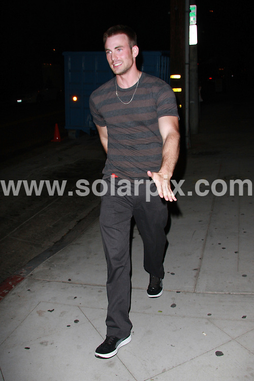 **ALL ROUND EXCLUSIVE PICTURES FROM SOLARPIX.COM**.**WORLDWIDE SYNDICATION RIGHTS**.**NO PUBLICATION IN AUSTRALIA, NEW ZEALAND,.DENMARK, GERMANY OR USA**.American Actor Chris Evans - not to be confused with the British DJ and wild man of the same name - of Fantastic Four fame full of energy while bar hopping in Hollywood. 9th September 2008..JOB REF: 7280 LAP (JS)       DATE: 09_09_2008.**MUST CREDIT SOLARPIX.COM OR DOUBLE FEE WILL BE CHARGED* *UNDER NO CIRCUMSTANCES IS THIS IMAGE TO BE REPRODUCED FOR ANY ONLINE EDITION WITHOUT PRIOR PERMISSION*