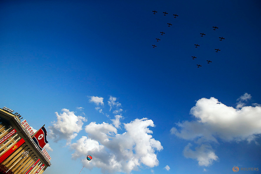 "Planes make number ""70"" as they fly over Pyongyang's main Kim Il Sung Square during the parade celebrating the 70th anniversary of the founding of the ruling Workers' Party of Korea October 10, 2015. Isolated North Korea marked the 70th anniversary of its ruling Workers' Party on Saturday with a massive military parade overseen by leader Kim Jong Un, who said his country was ready to fight any war waged by the United States.   REUTERS/Damir Sagolj"