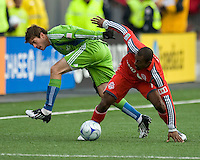 Brad Evans (left) of the Seattle Sounders FC and Marvell Wynne (right) of Toronto FC in MLS action at BMO Field on April 4, 2009.Seattle won 2-0.