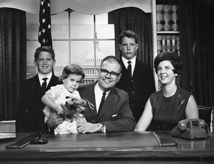 Congressman John Dingell's Christmas Card of he and his family in his office in the House Office Buildings.