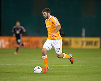 Will Bruin (12) of Houston Dynamo brings the ball upfield during the game at RFK Stadium in Washington,DC. D.C. United tied the Houston Dynamo, 1-1.  With the tie, Houston won the Eastern Conference and advanced to the MLS Cup.