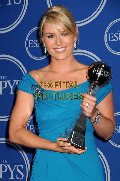 LINDSEY VONN.18th Annual ESPY Awards - Press Room held at Nokia Theatre L.A. Live, Los Angeles, California, USA, .14th July 2010..espys half length blue teal dress award winner trophy brooch .CAP/ADM/BP.©Byron Purvis/AdMedia/Capital Pictures.