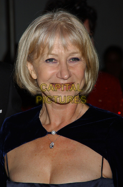 HELEN MIRREN.28th Annual Kennedy Center Honors held at the State Department. Washington D.C.USA, United States.3rd December 2005.Ref:ADM/LF.portrait headshot navy blue top plunging neckline cleavage.www.capitalpictures.com.sales@capitalpictures.com.© Capital Pictures..