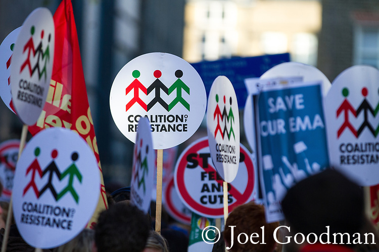 © Joel Goodman - 07973 332324 . 09/12/2010 . London , UK . Coalition of Resistance placards on the march . Students and their supporters demonstrate in Parliament Square in London against government cuts to student support , Educational Maintenance Allowance ( EMA ) and rising university tuition fees . Photo credit : Joel Goodman