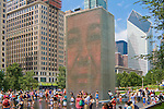 Children and families play in Jaume Plensa's Crown Fountain in MIllennium Park, Chicago, Illinois