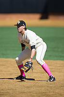 Wake Forest Demon Deacons first baseman Will Craig (22) on defense against the Virginia Tech Hokies at Wake Forest Baseball Park on March 7, 2015 in Winston-Salem, North Carolina.  The Hokies defeated the Demon Deacons 12-7 in game one of a double-header.   (Brian Westerholt/Four Seam Images)