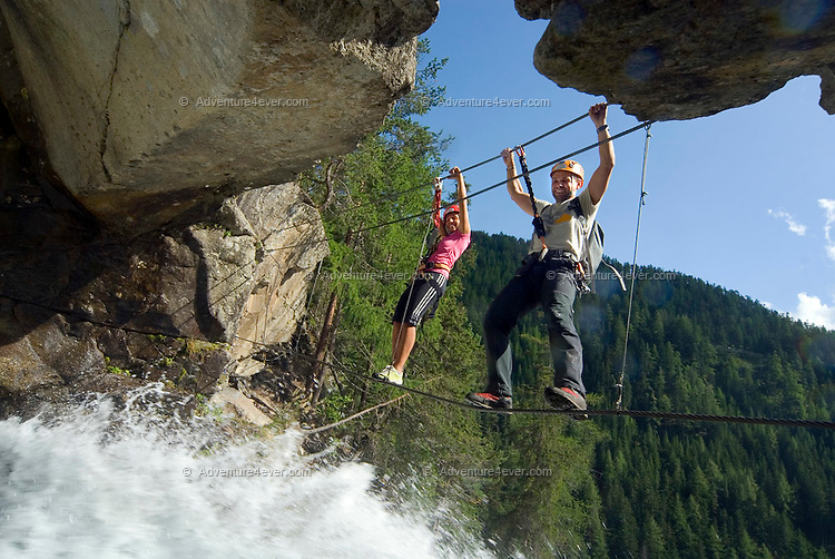Umhausen, Oetztal, Tyrol, Austria, August 2009. Climbers at the Stuibenfall in Umhausen-Niederthai, pass a waterfall. A valley full of opposites, between action and relaxation. Lush green meadows and mighty rocks. White waters and eternal ice. Photo by Frits Meyst/Adventure4ever.com