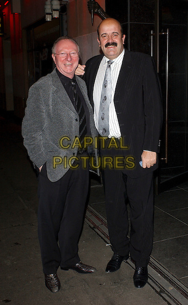 DENNIS TAYLOR & WILLIE THORNE.Vinnie Jones Celebrity Poker Tournament at The Sportsman Casino, London, UK..January 18th, 2006.Ref: BEL.full length black grey gray suit.www.capitalpictures.com.sales@capitalpictures.com.©Capital Pictures