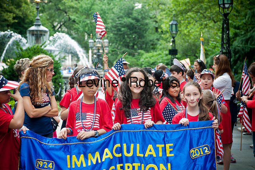 Students from the Immaculate Conception School in Astoria, Queens march in the annual Flag Day Parade on Thursday, June 14, 2012, starting at New York City Hall Park. Flag Day, was created by proclamation by President Woodrow Wilson on June 14, 1916 as a holiday honoring America's flag but it was not until 1949 when it became National Flag Day.  The holiday honors the 1777 Flag Resolution where the stars and stripes were officially adopted as the flag of the United States. (© Richard B. Levine)