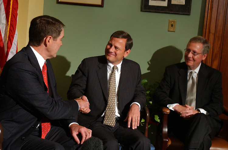 Senate Majority Leader Bill Frist, R-Tenn., left, shakes hands with Supreme Court justice nominee, John Roberts, during a meeting in which Senators and Roberts made brief remarks to the press.  Sen. Mitch McConnell, R-Ky., appears at right.