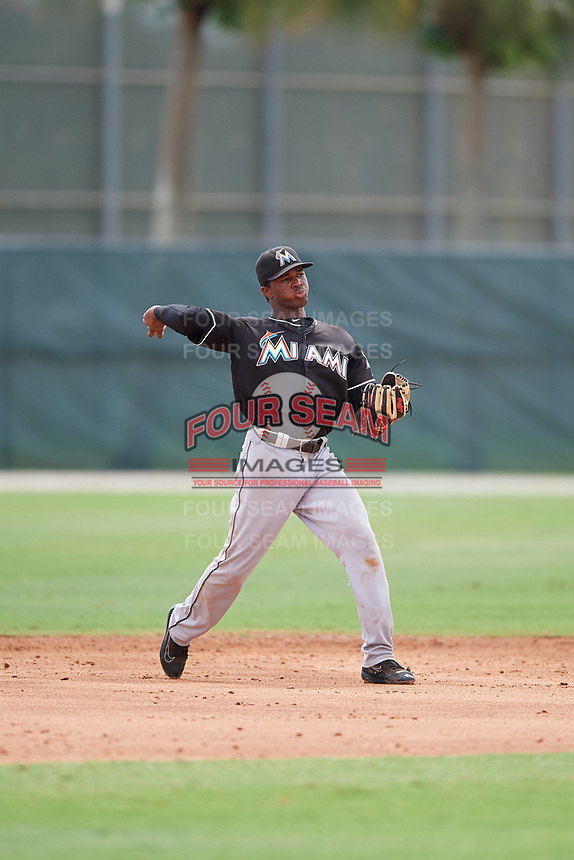 GCL Marlins shortstop Ronal Reynoso (3) throws to first base during a game against the GCL Astros on July 22, 2017 at Roger Dean Stadium Complex in Jupiter, Florida.  GCL Astros defeated the GCL Marlins 5-1, the game was called in the seventh inning due to rain.  (Mike Janes/Four Seam Images)