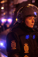 Police woman during at a big demonstration held in Copehangen on Dec 12. United Nations Climate Change Conference (COP15) was held at Bella Center in Copenhagen from the 7th to the 18th of December, 2009. A great deal of groups tried to voice their opinion and promote their cause in various ways. The conference and demonstrations was covered by thousands of photographers and journalists from all over the world...©Fredrik Naumann/Felix Features.