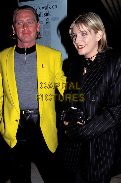 MICHELLE COLLINS & DATE.bright yellow jacket .Ref:007.www.capitalpictures.com.sales@capitalpictures.com.© Capital Pictures.