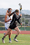 Torrance, CA 05/09/13 - Alexis Cheney (Oak Park #4) and Jackie Adelsberg (Agoura #12) in action during the 2013 Los Angeles area Girls Varsity Lacrosse Championship.  Agoura defeated Oak Park 13-7.