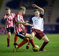 Lincoln City U18's Jon Smith vies for possession with South Shieldsy U18's Ollie Scott<br /> <br /> Photographer Chris Vaughan/CameraSport<br /> <br /> The FA Youth Cup Second Round - Lincoln City U18 v South Shields U18 - Tuesday 13th November 2018 - Sincil Bank - Lincoln<br />  <br /> World Copyright © 2018 CameraSport. All rights reserved. 43 Linden Ave. Countesthorpe. Leicester. England. LE8 5PG - Tel: +44 (0) 116 277 4147 - admin@camerasport.com - www.camerasport.com