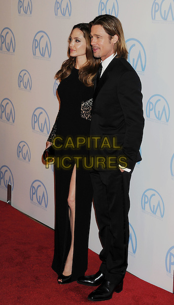 Angelina Jolie & Brad Pitt.The 23rd Annual Producers Guild Awards at the Beverly Hilton Hotel in Beverly Hills, California, USA..January 21st, 2012.full length black lace lace sleeves cut out  slit split peep toe shoes away suit side profile couple goatee facial hair.CAP/ROT/TM.©Tony Michaels/Roth Stock/Capital Pictures