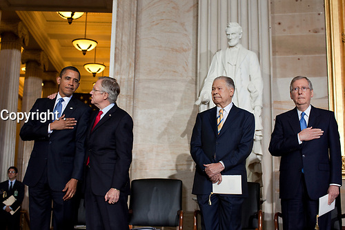 Sen. Harry Reid (D-NV) talks with President Barack Obama during the Congressional Gold Medal Ceremony in honor of former Massachusetts Senator Edward W. Brooke, second right, at the U.S. Capitol in Washington, D.C., Oct. 28, 2009.  Sen. Mitch McConnell (R-KY), right. (Official White House Photo by Pete Souza)<br /> <br /> This official White House photograph is being made available only for publication by news organizations and/or for personal use printing by the subject(s) of the photograph. The photograph may not be manipulated in any way and may not be used in commercial or political materials, advertisements, emails, products, promotions that in any way suggests approval or endorsement of the President, the First Family, or the White House.
