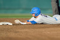UCLA CF Beau Amaral slides into second during Game Two of the NCAA Division One Men's College World Series Finals on June 29th, 2010 at Johnny Rosenblatt Stadium in Omaha, Nebraska.  (Photo by Andrew Woolley / Four Seam Images)